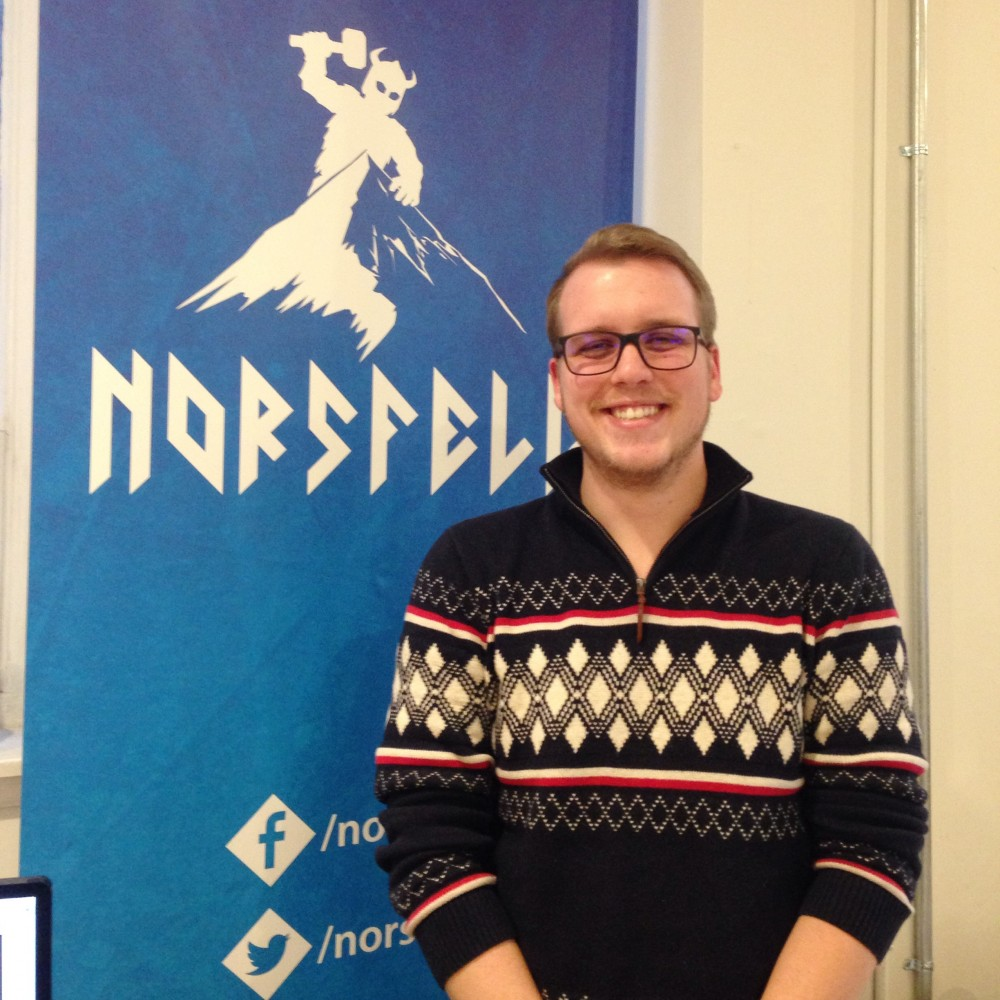 Our amazing intern Terence in front of the Norsfell banner